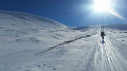 Glenshee Ski School pupil on ski lift in sunshine