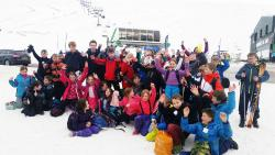 Glenshee Ski School group of school children happy to start skiing lessons